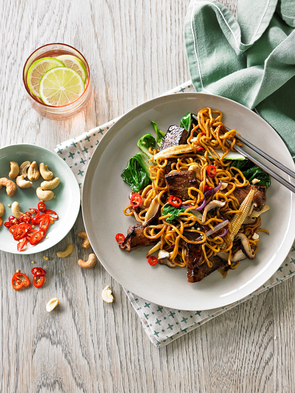Stir-fried beef with Asian greens and cashews