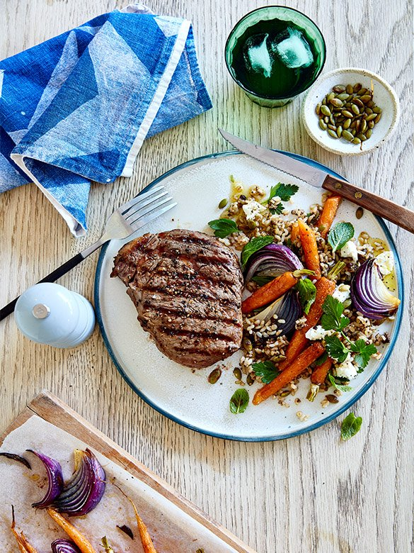Peppered scotch fillet with carrot and herb salad