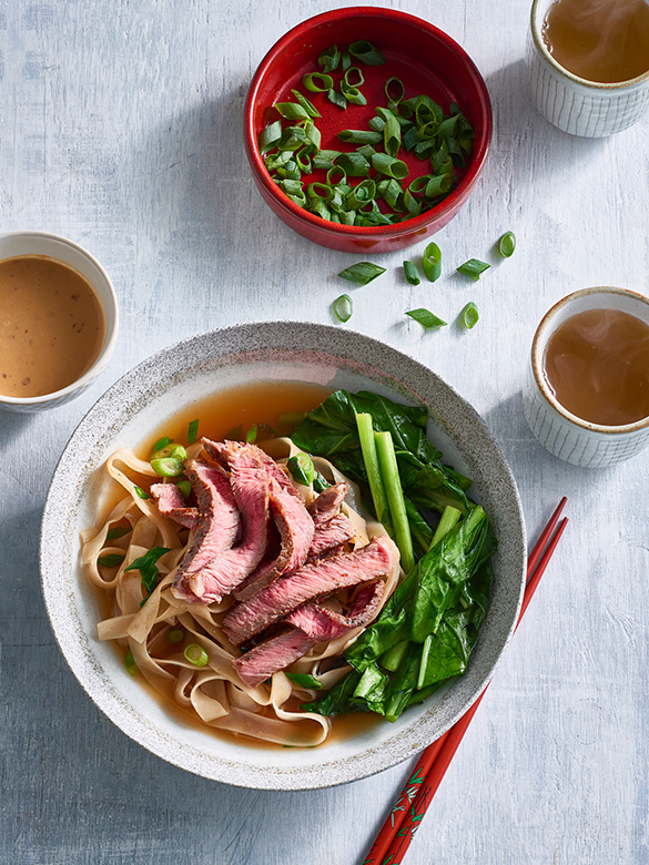 Beef noodle soup with Asian greens